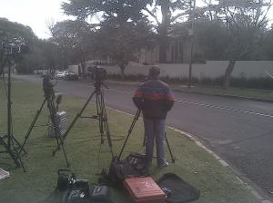Journalists gather outside Nelson Mandela's Houghton home last week